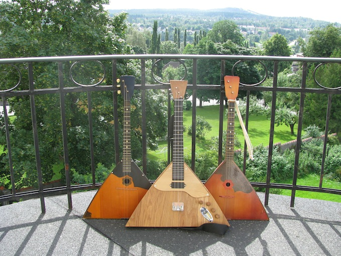 Two acoustic balalaikas and one electric balalaika.